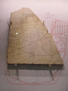 Fragment of the 'Forma Urbis Romae', a stone map of the city. Here you can see a bit of the Forum, the Temple of Castor and Pollux